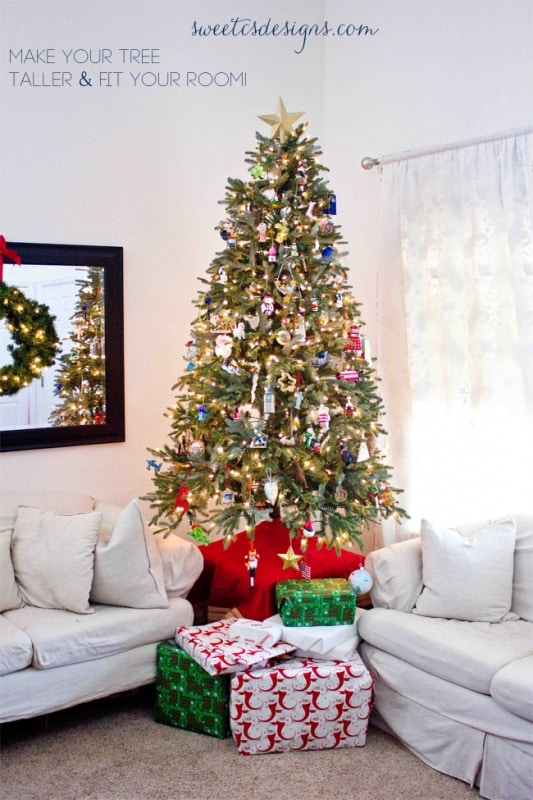 make your tree taller-- this is an awesome tip to use smaller trees in a room with high ceilings!